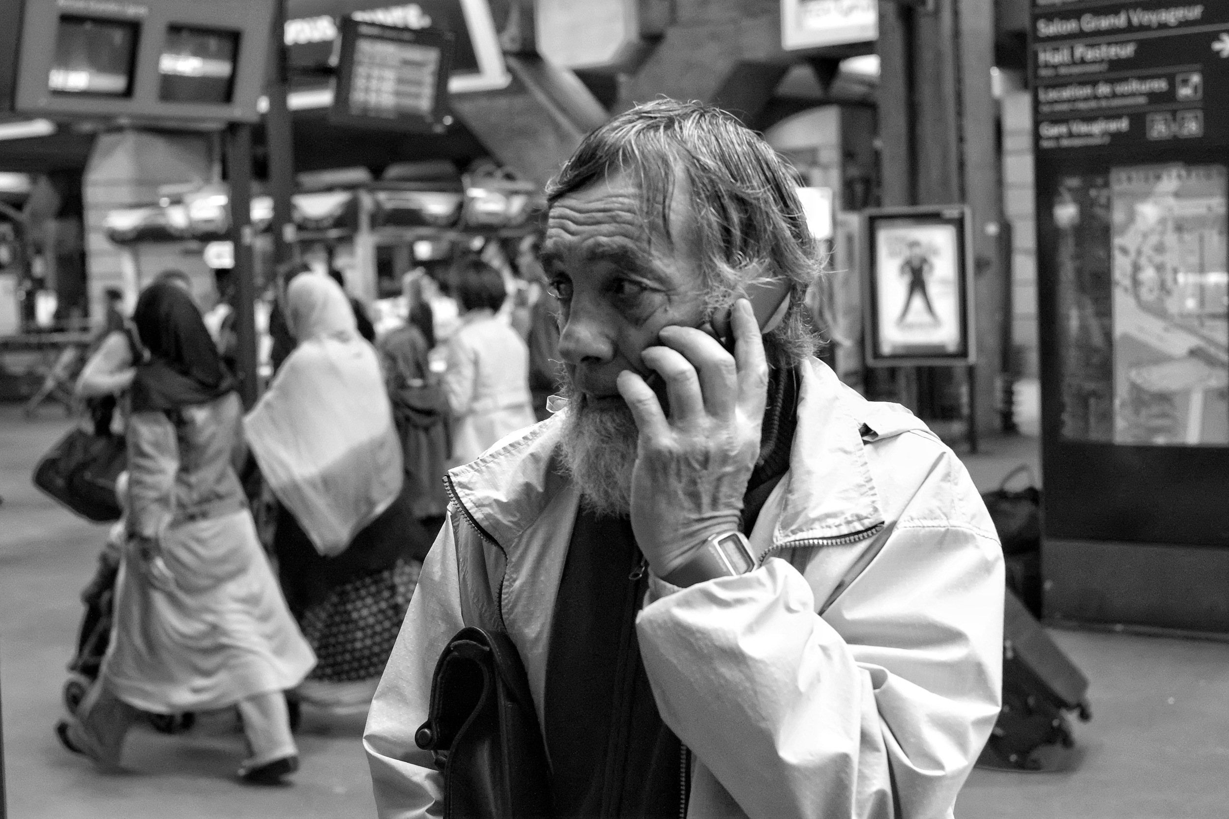 Man on his telephone at Montparnasse station in Paris - Fuji X-Pro1