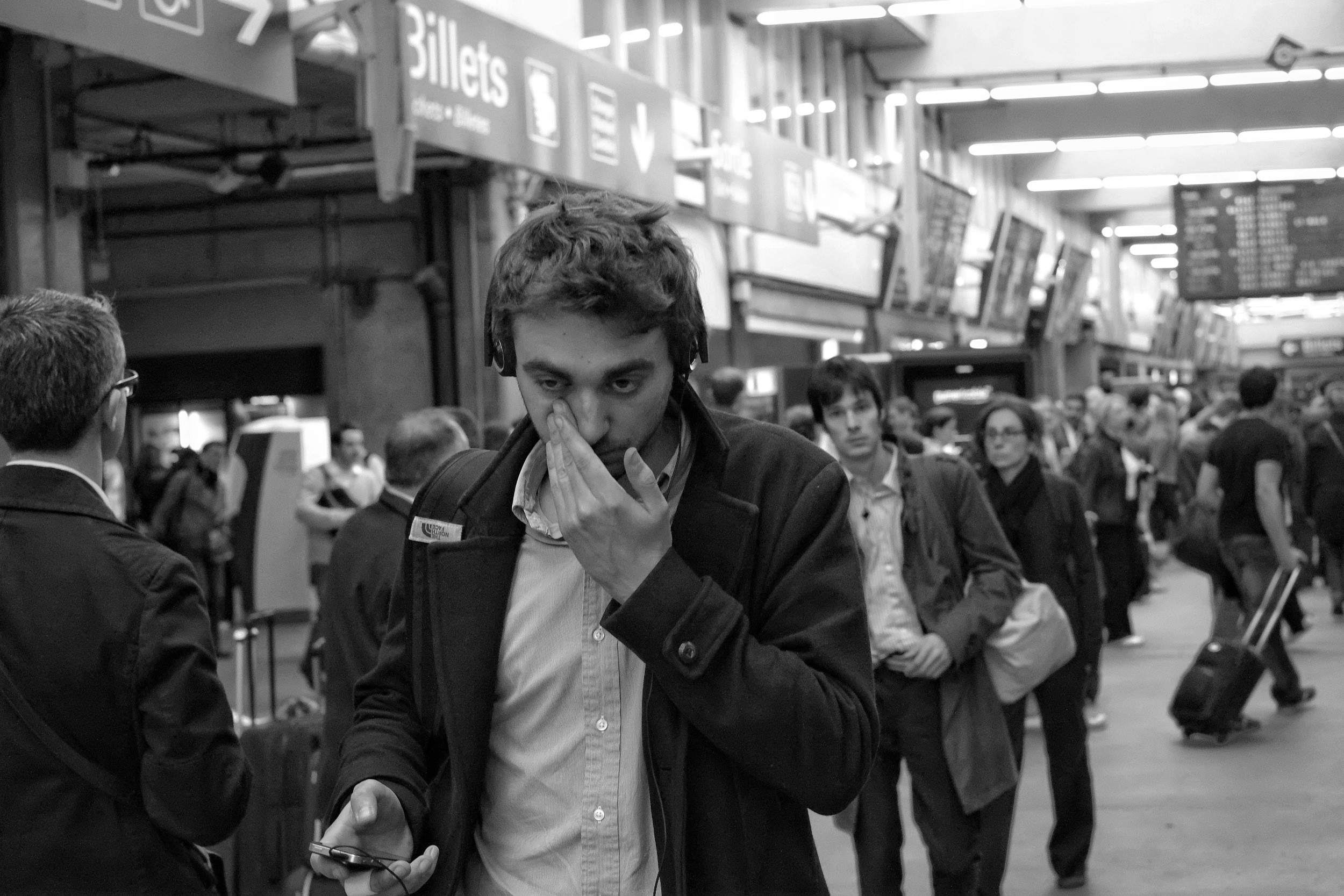 Tired commuter at Montparnasse station in Paris - Fuji X-Pro1