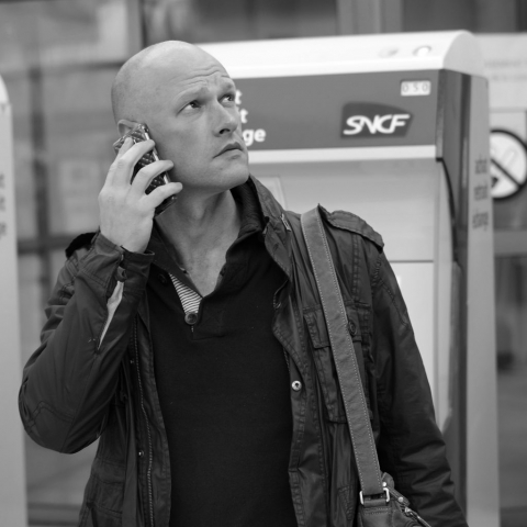 Man on his telephone at Nantes train station - Fuji X-Pro1