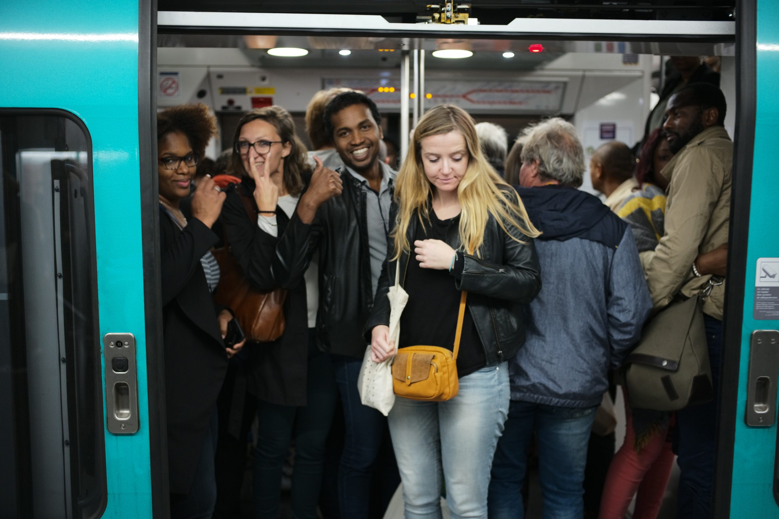Great gang of happy people on a jam packed RER A train in Paris - Leica M10