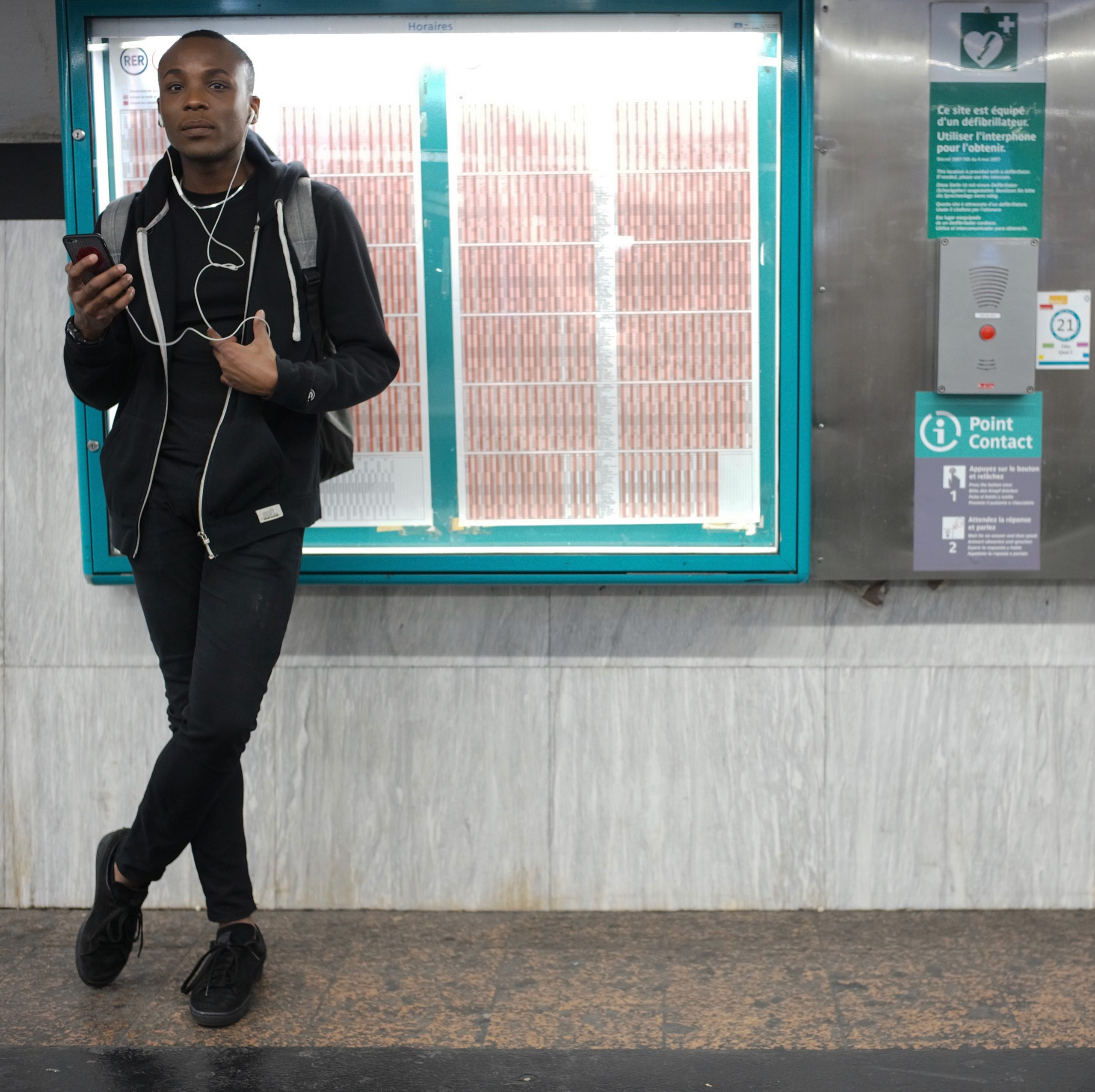 Man waiting for the RER A train at Charles du Gaule station in Paris - Leica M10