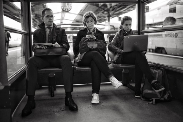 Tree commuters working on their devices at Nantes train station - Leica M10