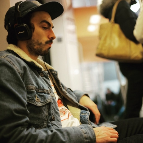 Man listening to music on Marshall headphones in the RER A - Leica M10