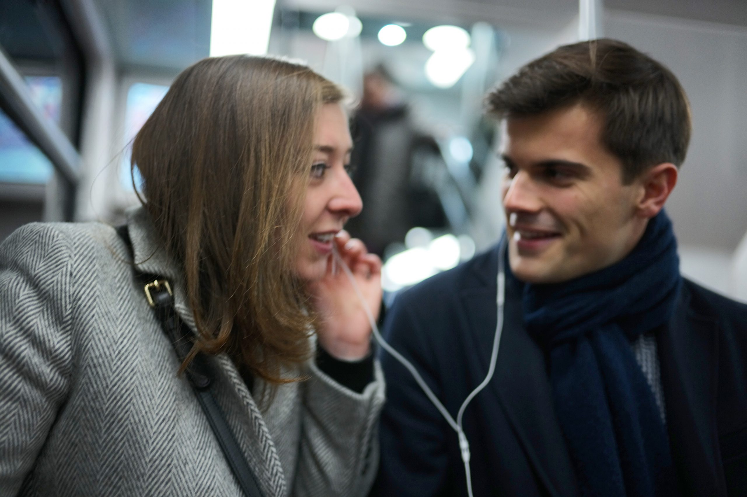 Young couple in love happily listing to music on the RER A in Paris - Leica M10