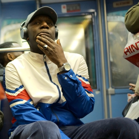 Man reflecting deeply and listening to music on the Paris metro - Leica M10
