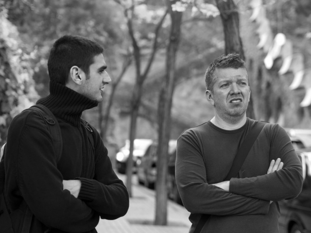 Men talking, Barcelona - Panasonic GX-1