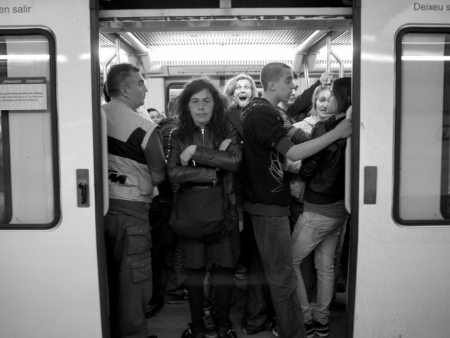 One happy and one sad on the packed Barcelona metro - Panasonic GX1