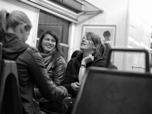 Happy people chatting on Transilien train in Paris - Fuji X-Pro1