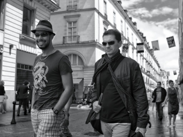 Happy guys walking in Nantes - Fuji X-Pro1 Cool rapper dude in Nantes - Fuji X-Pro1, Man walking with umbrella in Nantes - Fuji X-Pro1 with Minolta Rokkor MC 24mm F2.8 lens