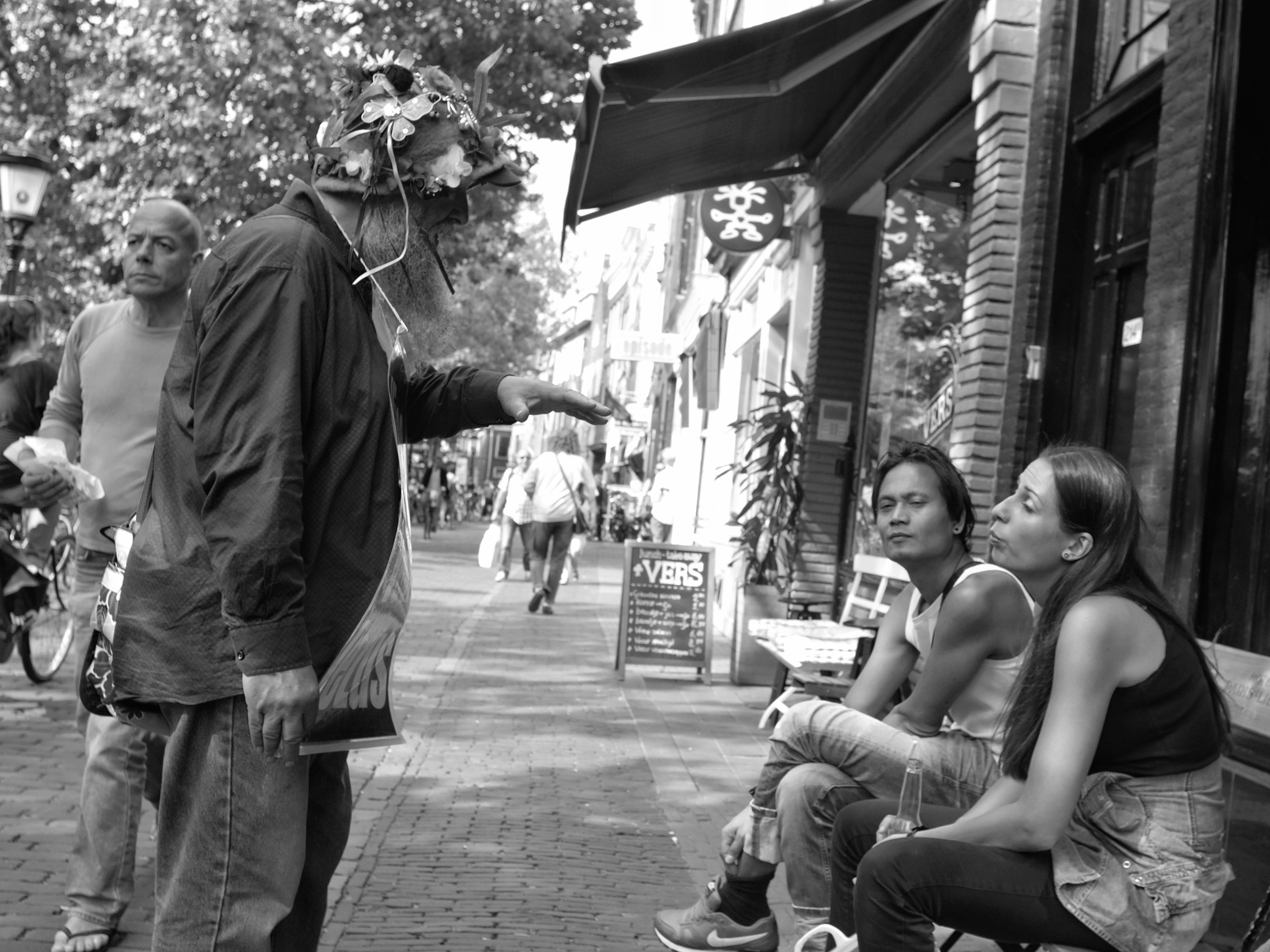 People talking in Utrecht - Fuji X-Pro1, Man walking with umbrella in Nantes - Fuji X-Pro1 with Minolta Rokkor MC 24mm F2.8 lens